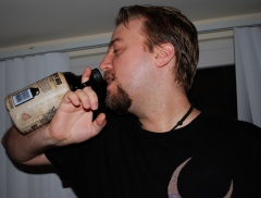 Jason demonstrates the way beer enthusiasts would drink from a bottle like this back in the day.